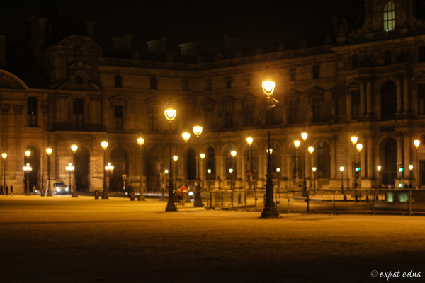 Parisian lamp posts at midnight - Expat Edna