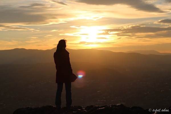 Me watching the sunset from Arthur's Seat, Edinburgh - by Expat Edna