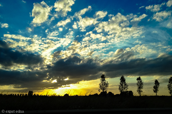 Sunset on the drive from Paris to Brussels by Expat Edna