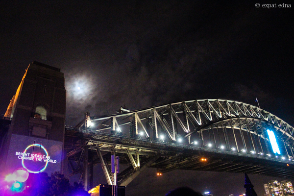 Sydney NYE - Bright Ideas Can Change the World on Harbour Bridge by Expat Edna