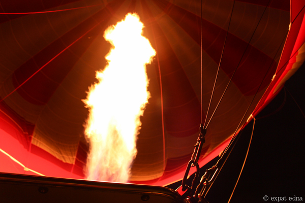 Firing up hot air balloon by Expat Edna